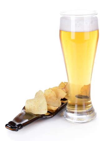 Glass of beer with snack isolated on white photo