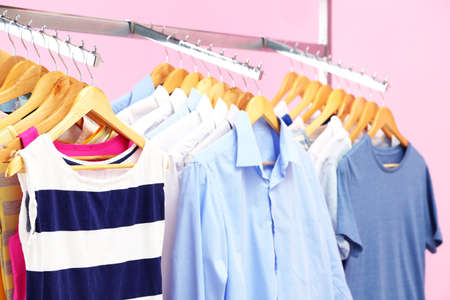 swear: Different clothes on hangers, on pink background