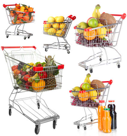 Trolleys with different fruits and vegetables isolated on white photo