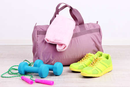 Sports bag with sports equipment in gymnasium Stock Photo