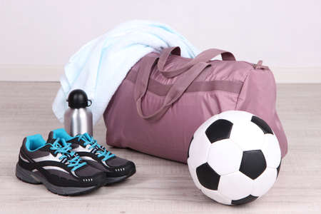 haversack: Sports bag with sports equipment in gymnasium Stock Photo
