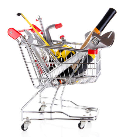 Construction tools in shopping cart isolated on white Stock Photo - 25879611