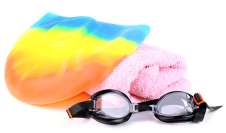Set for pool: swim cap, goggles and towel isolated on white Stock Photo - 25879623