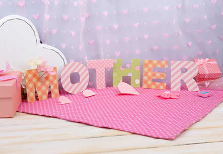 Mother- lettering of handmade paper letters  photo