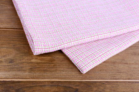 Kitchen towels on wooden background photo