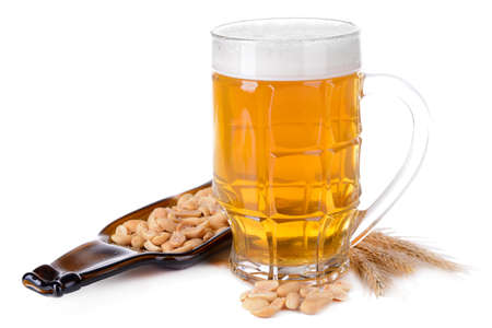Glasses of beer with snack isolated on white photo