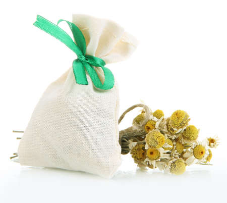 Textile sachet pouch with dried flowers isolated on white photo