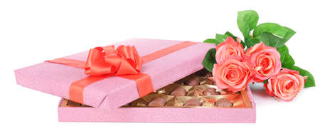 fancy sweet box: Delicious chocolates in box with flowers isolated on white