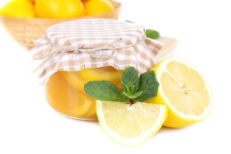 Tasty lemon jam isolated on white photo