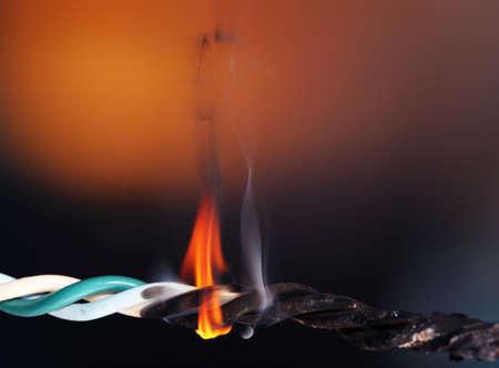 Short circuit, burnt cable, on dark color background Reklamní fotografie