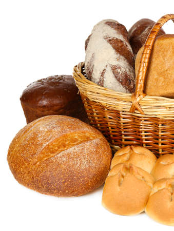 Composition with bread and rolls in wicker basket isolated on white photo