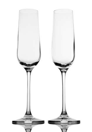 Empty champagne glasses, isolated on white photo