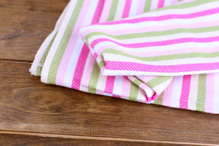 dishtowel: Kitchen towels on wooden  Stock Photo