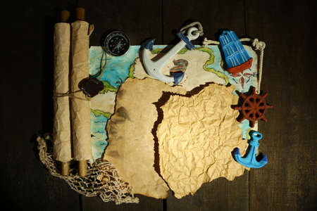 Old paper with sea accessories, isolated on wooden  photo