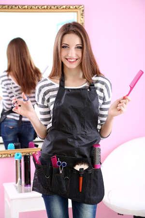 Beautiful girl hairdresser in beauty salon photo