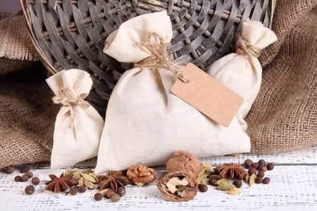 Sacks full with spices, on wooden table, on sackcloth  photo
