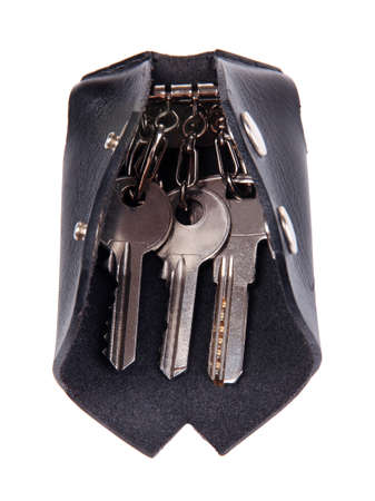 Black leather key case isolated on white photo