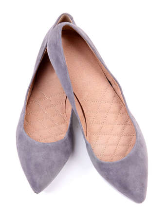 Beautiful grey female shoes, isolated on white photo