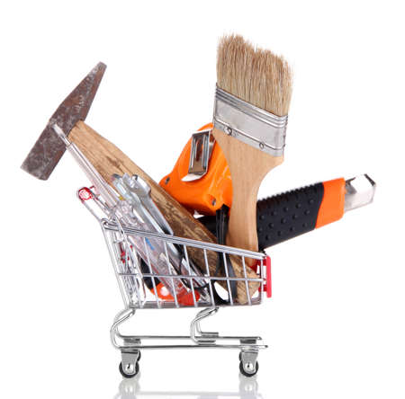 Construction tools in shopping cart isolated on white Stock Photo - 26285228