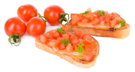 Delicious bruschetta with tomatoes isolated on white photo