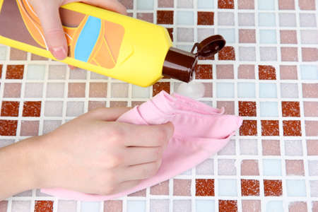 Hand cleaning mosaic wall photo