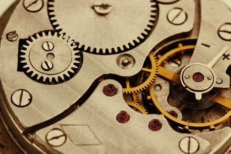 Clockwork details, pinions and wheels closeup photo
