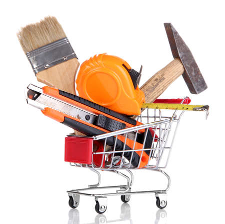 hard sell: Construction tools in shopping cart isolated on white