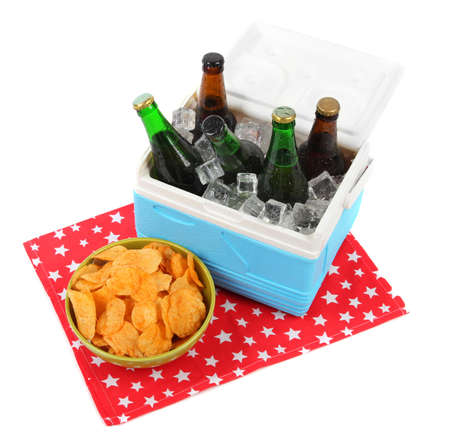 ice chest: Ice chest full of drinks in bottles on color napkin, isolated on white