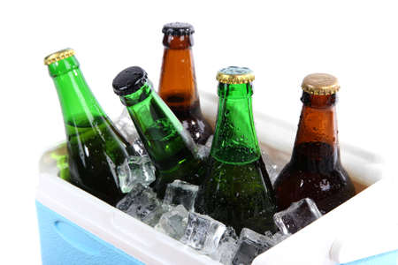 Ice chest full of drinks in bottles, isolated on white photo