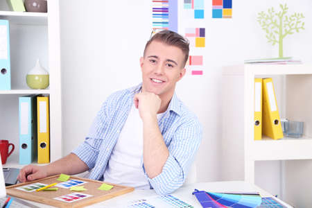 Young creative designer working at office photo