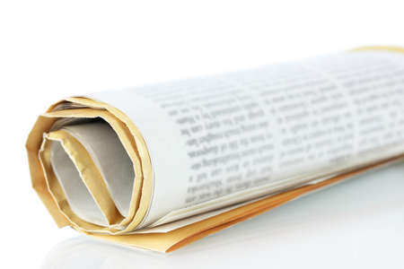 Roll of newspaper isolated on white  photo