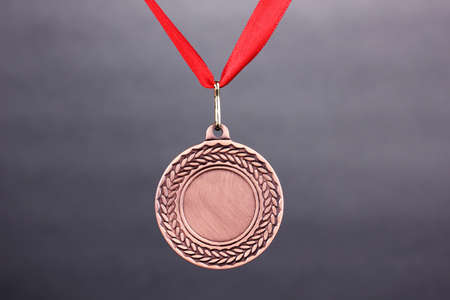 Three medals on grey background photo