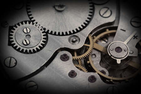 Clockwork details, pinions and wheels closeup photo
