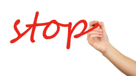 Stop hand writing on transparent board photo