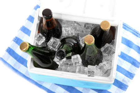 insulated drink container: Ice chest full of drinks in bottles on color napkin, isolated on white