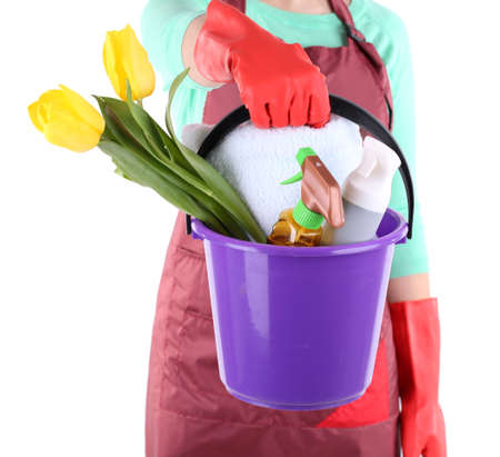 Housewife holding bucket with cleaning equipment. Conceptual photo of spring cleaning. Isolated on white photo