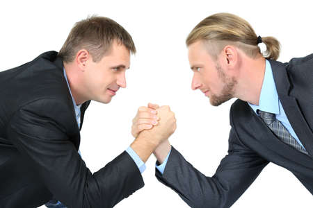 robustness: Arm wrestling of business people isolated on white
