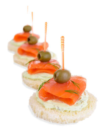 Delicious canapes isolated on white photo