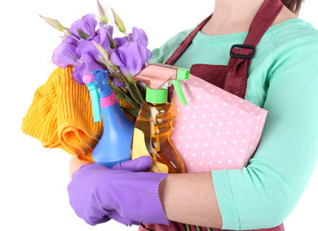 Housewife holding cleaning equipment in her hands. Conceptual photo of spring cleaning. Isolated on white photo