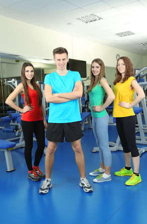 Young beautiful peoples in gym photo