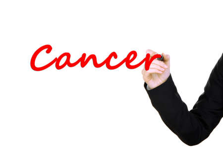 Hand writing Cancer on transparent board photo