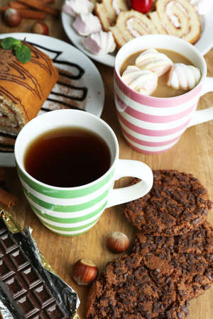 Cup of tea and sweets close up photo
