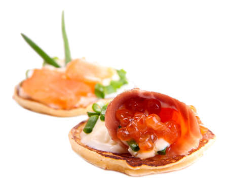 Pancakes with red caviar and salmon,  isolated on white photo