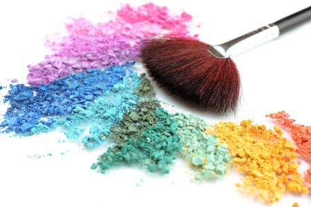Rainbow crushed eyeshadow and professional make-up brush close up Stock Photo
