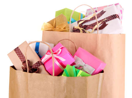 Presents in paper bags isolated on white photo