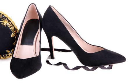 Beautiful black female shoes and decorative heart, isolated on white photo