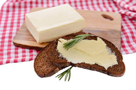 Slice of rye bread with butter, isolated on white photo
