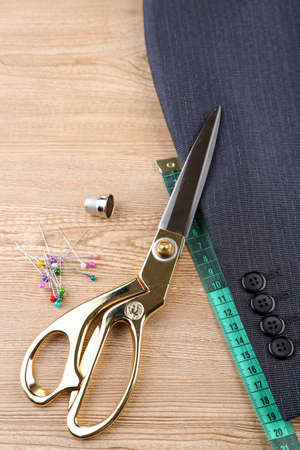 Business suit tailoring, on wooden background Stock Photo