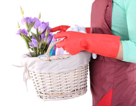Housewife holding basket with cleaning equipment. Conceptual photo of spring cleaning. Isolated on white photo