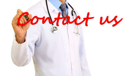 Doctor writing Contact us on transparent board photo